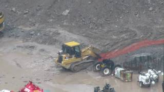 CAT 963C track loader working in a foundation