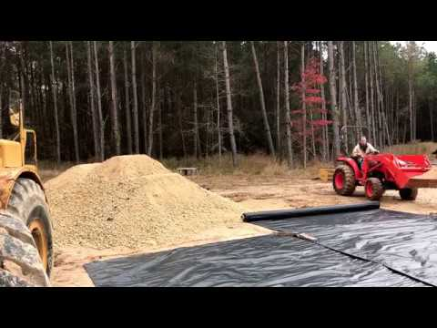 Spreading Rock for Driveway (Rolling out Geotextile)