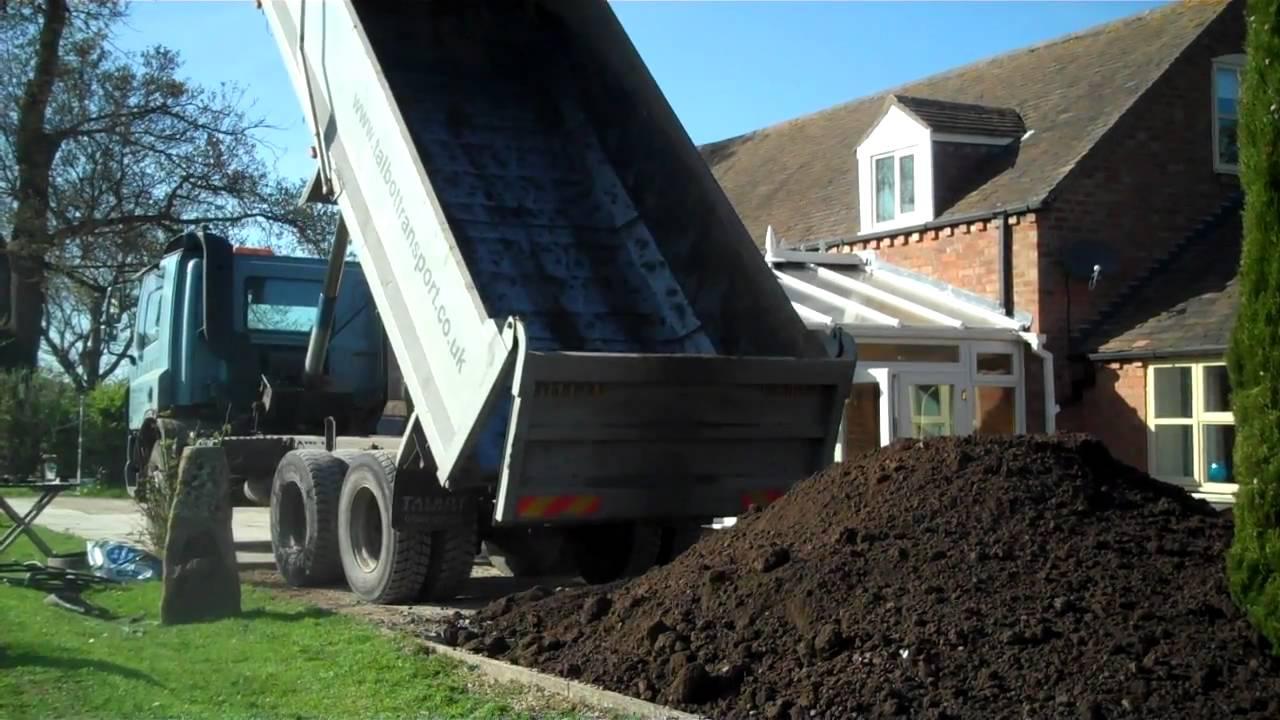 Unloading 10 tons of top soil youtube