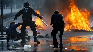 RAW: German riot police storm & beat