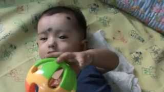 5 Months Old Cute Baby Playing Toy in Bed.