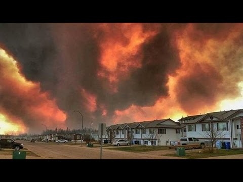 Thousands Flee Devastating Wildfires (VIDEO)