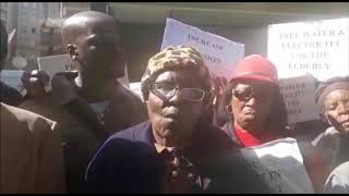 WATCH: Elderly persons threaten to burn government buildings