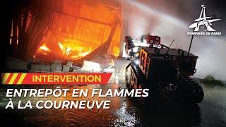 Les pompiers de Paris interviennent pour un violent feu d'entrepôt de La Courneuve (93)