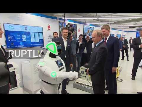 'Hello, Vladimir Vladimirovich' - Putin shakes hands with robot during Perm IT expo