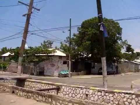 Driving through dangerous Trenchtown district Jamaica