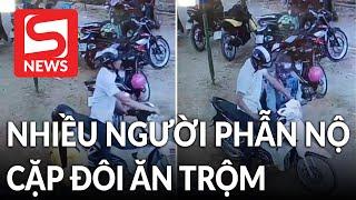 Đôi nam nữ ngang nhiên lấy trộm mũ bảo hiểm xịn ở bãi xe khiến nhiều người phẫn nộ