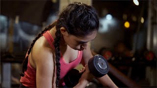 Closeup shot of an Indian female athlete lifting weights - women fitness concept