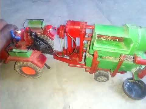 Small tractor and machine is doing the work of farming