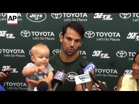 Eric Decker's Baby Son Grabs The Mic (And Chomps It)