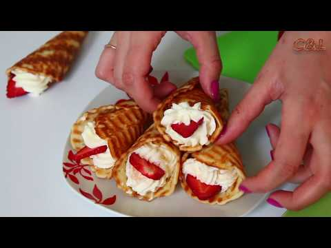 Waffle horns with cream and strawberries. Preparation of organic bakery products in homemade.