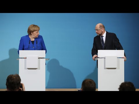 Rival German parties agree to coalition talks