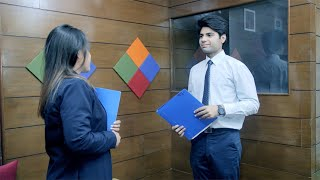 An Indian male and female signing business contract, exchanging files and shaking hands