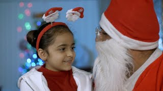 Closeup shot of little girl talking to her loving Santa during Christmas time