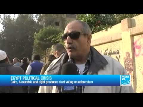 Egypt political crisis - constitutional referendum: report in front of a polling station in Cairo