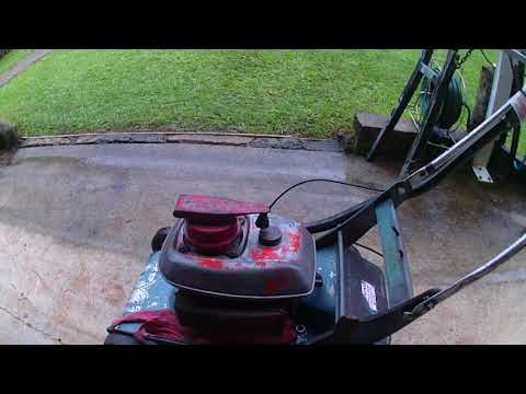 Friend's earky 70's Rover two stroke push mower still in use