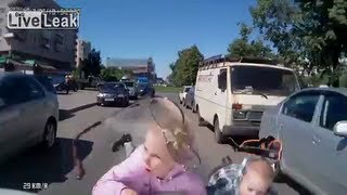 Stupid Mother Walks Her Kids Into Path Of Moving Car
