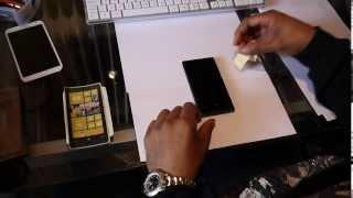 Put a screen protector on smartphone screen NO AIR BUBBLES!