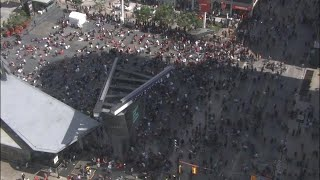 Crowd runs away from Eaton Centre after reports of shooting