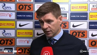 Kilmarnock players celebrate in background as Steven Gerrard reacts to Rangers loss at Rugby Park