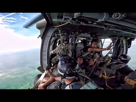 Parachute Jump Into Water From Black Hawk Helicopter