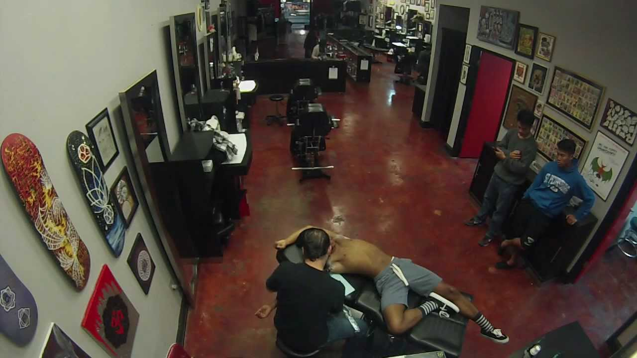Mike T making a tattoo at Atomic Tattoos in Tyrone Mall, St ...