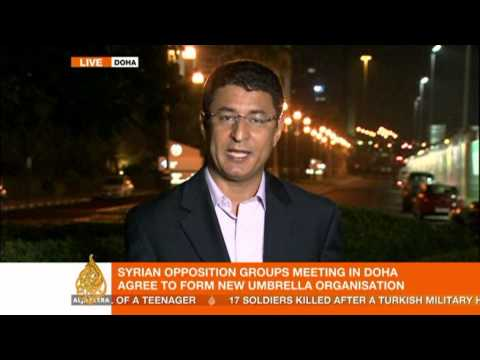 New Syrian opposition debates key issues in Doha
