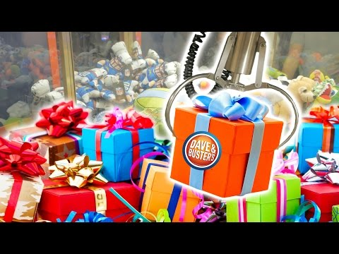 Cleaning out the claw machine for birthday presents at Dave and Buster's! | The Crane Couple