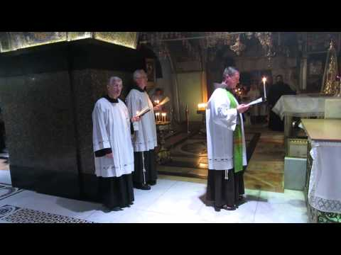 Franciscan monks in prayer at Calvary (Golgotha), the Church of the Holy Sepulchre, Jerusalem