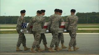 Bodies of slain troops arrive home