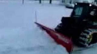 JD 318D Skid Loader with a BOSS Snow Blade & McLaren tracks