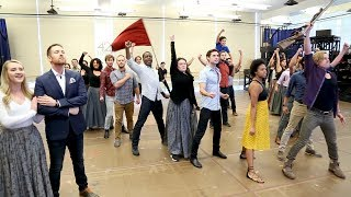 watch nick cartell the cast of les miserables raise the flag in rehearsal