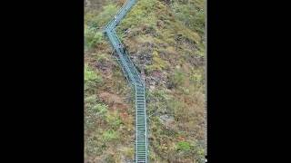 2556 steps of ladder build along the cliff for villagers living on top of the mountain