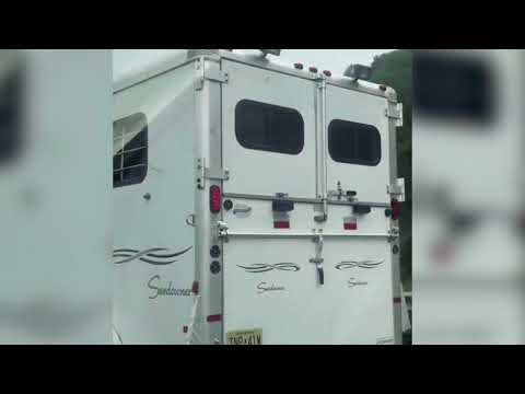 Black Man hauled  in Horse Trailer while driven by a White Man