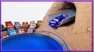 Disney Cars Mcqueen go through Sand Tunnel into blue colored water