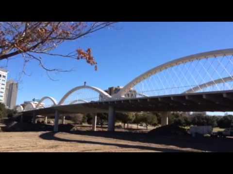 Man rides bike over West Seventh Street bridge arches