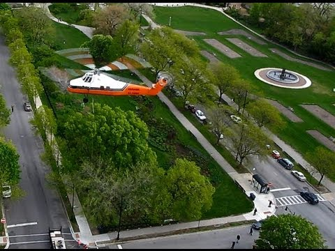 Heavy Lift Helicopter in Chicago. Moving HVAC unit from highrise. HD HQ. Taken from my living room.