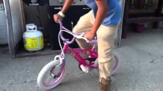 Riding a little girl bike and doing tricks