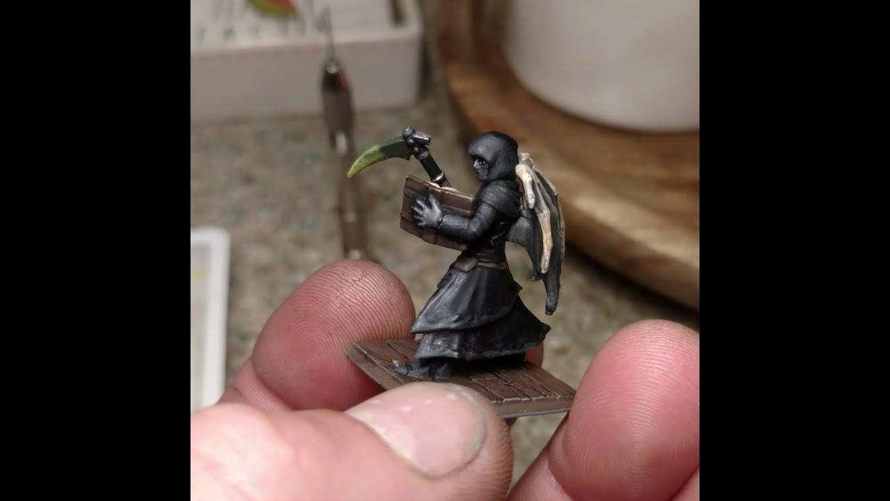 Beecher's Miniature of Olin the Fallen Aasimar Warlock, painted by DoD Spec  Ops