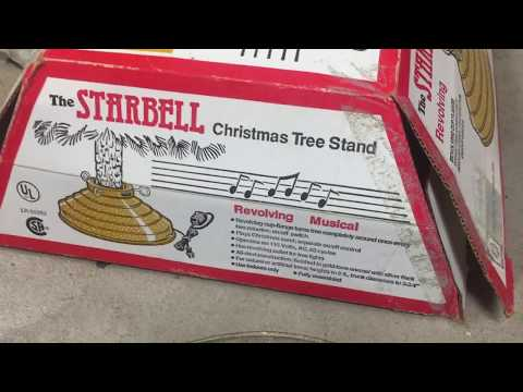 The Starbell Revolving Musical Christmas Tree Stand