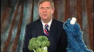 Secretary Tom Vilsack talks with Cookie Monster