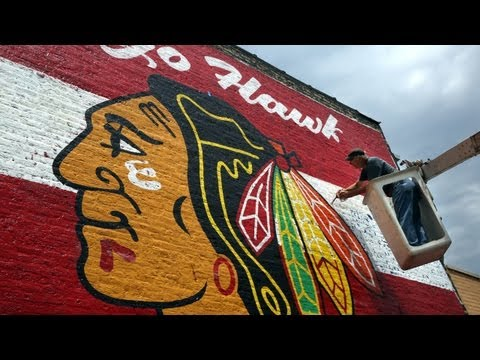 Giant Blackhawks mural painted on brick wall