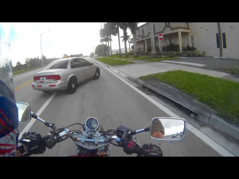 [USA] Car makes a sudden left lane change to make a right turn. Too late for motorcycle to stop
