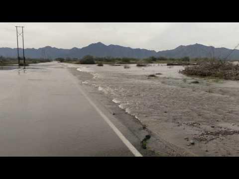 91 St ave Phx AZ Car Stranded Salt River Runs Again and Floods Sreets