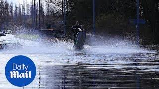 Moment Jet-ski rider makes most of flooded Yorkshire roads