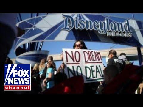 DACA recipients block path to Disneyland in protest