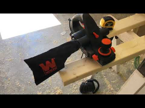 Using an electric hand planer to smooth out the edges on DIY shaker style cabinet doors