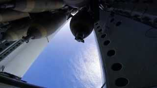 b 52 dropping bombs from the bomb bay doors daytime