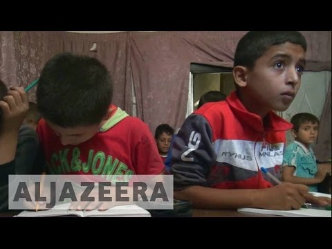 Children attend underground school in Syria's Aleppo