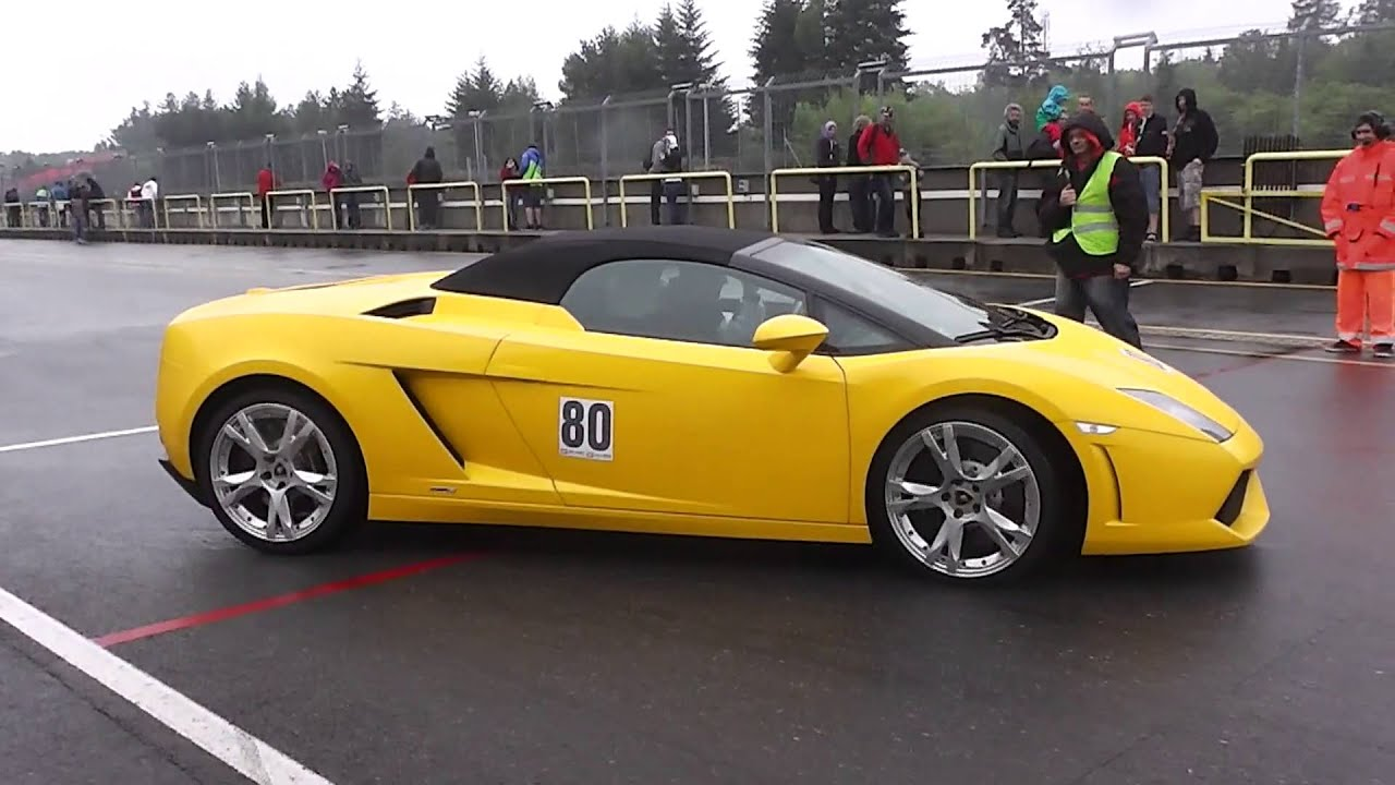 yellow lamborghini gallardo lp560 4 spyder in action on track